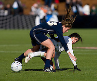 Alina Garciamendez (4) of Stanford fights for the ball with Courtney Barg (13) of Notre Dame during the final of the NCAA Women's College Cup at WakeMed Soccer Park in Cary, NC.  Notre Dame defeated Stanford, 1-0.