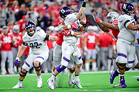 Indianapolis, IN - DEC 1, 2018: Northwestern Wildcats quarterback Clayton Thorson (18) is sacked by Ohio State Buckeyes defensive end Chase Young (2) causing a fumble during first half action of the Big Ten Championship game between Northwestern and Ohio State at Lucas Oil Stadium in Indianapolis, IN. (Photo by Phillip Peters/Media Images International)