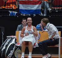 The Netherlands, Den Bosch, 16.04.2014. Fed Cup Netherlands-Japan, Dutch captain Paul Haarhuis on the bench with Kiki Bertens<br /> Photo:Tennisimages/Henk Koster