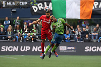 SEATTLE, WA - NOVEMBER 10: Justin Morrow #2 of Toronto FC and Joevin Jones #33 of the Seattle Sounders FC challenge for a header during a game between Toronto FC and Seattle Sounders FC at CenturyLink Field on November 10, 2019 in Seattle, Washington.