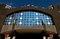 The sky reflects in the glass entrance of Bank of America stadium in downtown Charlotte, NC.