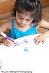 Education Preschool 3-5 year olds art activity girl drawing recognizable shapes using markers vertical