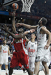 Real Madrid's Gustavo Ayon (c) and Felipe Reyes (r) and Olympiacos Piraeus' Bryant Dunston during Euroleague Final Match. May 15,2015. (ALTERPHOTOS/Acero)