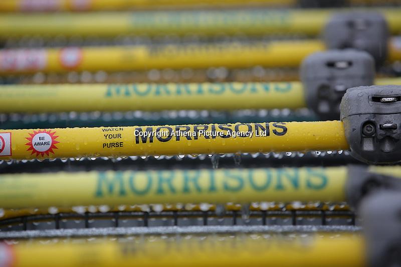 Shopping trolleys' handlebars at a Morrisons super market