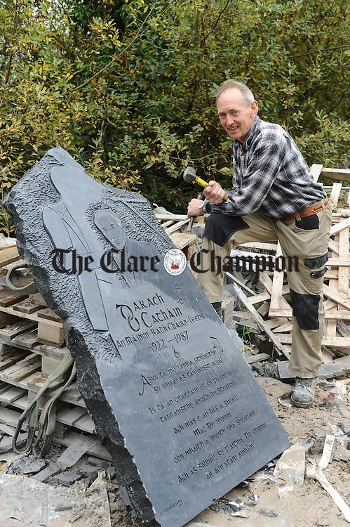Kilnamona sculptor Michael Mc Tigue with his Darach O Cathain memorial sculpture. Photograph by John Kelly.