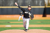 Wake Forest Demon Deacons relief pitcher Nate Jones (42) delivers a pitch to the plate against the Youngstown State Penguins at Wake Forest Baseball Park on February 24, 2013 in Winston-Salem, North Carolina.  The Demon Deacons defeated the Penguins 6-5.  (Brian Westerholt/Four Seam Images)
