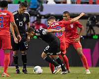 CHICAGO, IL - JULY 7: Andres Guardado #18 dribbles away from Christian Pulisic #10 during a game between Mexico and USMNT at Soldiers Field on July 7, 2019 in Chicago, Illinois.