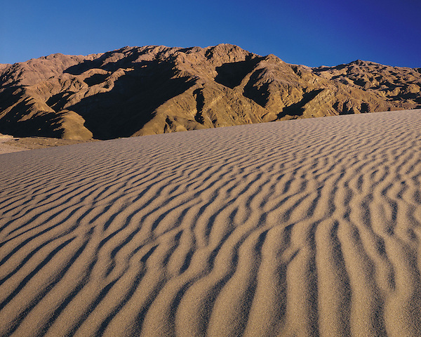 Sand Dunes and Panamint Range in Death Valley, Mohave Desert, Death Valley National Park, California, USA John offers private photo tours to Great Sand Dunes National Park and Rocky Mountain National Park, Colorado.