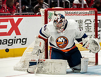 WASHINGTON, DC - JANUARY 31: Semyon Varlamov #40 of the New York Islanders  makes a save during a game between New York Islanders and Washington Capitals at Capital One Arena on January 31, 2020 in Washington, DC.