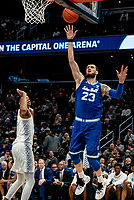 WASHINGTON, DC - FEBRUARY 05: Sandro Mamukelashvili #23 of Seton Hall shoots over Jamorko Pickett #1 of Georgetown during a game between Seton Hall and Georgetown at Capital One Arena on February 05, 2020 in Washington, DC.