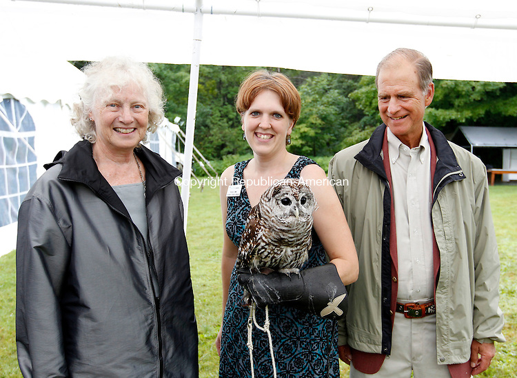 """Sharon, CT-10 August 2012-081012CM04-  Left to right, Carol (left) and Larry Rand (right) of Sharon pose with Wendy Miller, Education Program Manager at Audubon Sharon and """"Sophia"""" a Barred Owl during the Sharon Audubon and Miles Wildlife Sanctuary's 50th anniversary celebration in Sharon.       Christopher Massa Republican-American"""