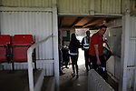Stamford AFC 2 Marine 4, 29/03/2014. Wothorpe Road, Northern Premier League. Players make their way into the stadium ahead of The Northern Premier League game between Stamford AFC and Marine from The Daniels Stadium. Marine won the game 4-2 in front of 320 supporters to boost their chances of relegation survival. Stamford AFC are moving to the brand new Zeeco Stadium at the end of the 2013/14 season Photo by Simon Gill.