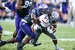 TCU Horned Frogs linebacker Marcus Mallet (54) and Texas Tech Red Raiders wide receiver Bradley Marquez (4) in action during the game between the Texas Tech Red Raiders and the TCU Horned Frogs at the Amon G. Carter Stadium in Fort Worth, Texas. TCU defeats Texas Tech 82 to 27.