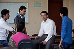 6 June 2013, Mazar-i-Sharif, Afghanistan.  Assistant Professor of English at Balkh University in Mazar-i-Sharif  Mohammad Shah speaks with some of his students on the campus. Prof Shah has travelled to Turkey to further his training and to provide a broader spectrum of teaching to his students under the Strengthening Higher Education Program ( SHEP). Many of the facilities and equipment at the University are being provided under the World Bank funded SHEP. The objective of the program is to restore basic operational performance at a group of core universities in Afghanistan. It aims to act as a catalyst to attract resources at Afghan tertiary education in the long term. SHEP is the first major education investment in Afghanistan by the World Bank. In 2008 it received $US 5 million from ARTF to expand infrastructure and equipment to Universities in Kabul, Nangarhar , Balkh and Kandahar.  Picture by Graham Crouch/World Bank