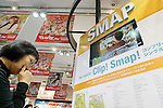 A fan looks at an exhibit space for the SMAP's new album SMAP 25 YEARS at the Tsutaya store in Shibuya on December 22, Tokyo, Japan. Japan's most popular boy band announced that they would split by the end of the year, and the special album includes 50 of the band's songs as selected by fans. (Photo by Rodrigo Reyes Marin/AFLO)