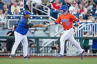Florida Gators first baseman Peter Alonso (20) rounds third base hitting a home run against the Virginia Cavaliers in Game 13 of the NCAA College World Series on June 20, 2015 at TD Ameritrade Park in Omaha, Nebraska. The Cavaliers beat the Gators 5-4. (Andrew Woolley/Four Seam Images)