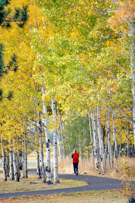 lady walking dog on path at Black Butte Ranch. Oregon