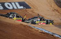 Dec. 11, 2011; Chandler, AZ, USA;  LOORRS pro 4 drivers Kyle LeDuc (99) and Todd LeDuc (4) during the Lucas Oil Challenge Cup at Firebird International Raceway. Mandatory Credit: Mark J. Rebilas-