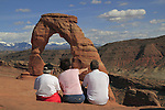 Family enjoying the view at Delicate Arch in Arches National Park, Utah. .  John offers private photo tours in Arches National Park and throughout Utah and Colorado. Year-round.