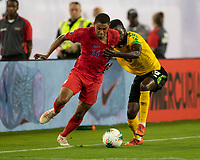 NASHVILLE, TN - JULY 3: Reggie Cannon #14 and Kemar Lawrence #20 contest the ball during a game between Jamaica and USMNT at Nissan Stadium on July 3, 2019 in Nashville, Tennessee.
