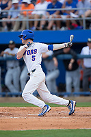 Dalton Guthrie (5) of the Florida Gators follows through on his swing against the Wake Forest Demon Deacons in Game One of the Gainesville Super Regional of the 2017 College World Series at Alfred McKethan Stadium at Perry Field on June 10, 2017 in Gainesville, Florida.  The Gators defeated the Demon Deacons 2-1 in 11 innings.  (Brian Westerholt/Four Seam Images)