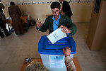 KIRKUK, IRAQ: A Kurdish man casts his ballot...Residents of the city of Kirkuk vote for the first time.  Because of violence in the ethnically mixed city, Kirkuk was excluded from the 2005 elections...Photo by Kamaran Najm/Metrography