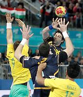 Spain's Antonio Garcia Robledo (f) and Australia's Martin Najdovski (l) and Daniel Kelly during 23rd Men's Handball World Championship preliminary round match.January 15,2013. (ALTERPHOTOS/Acero) /NortePhoto