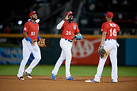 Buffalo Bisons Socrates Brito (51), Anthony Alford (26), and Richard Urena (16) celebrate closing out an International League game against the Norfolk Tides on June 21, 2019 at Sahlen Field in Buffalo, New York.  Buffalo defeated Norfolk 1-0, the second game of a doubleheader.  (Mike Janes/Four Seam Images)