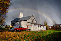 A rainbow arcs behind a Westerville, Ohio, barn at the trailing edge of a hail storm on a warm fall day.