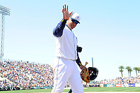 Detroit Tigers third baseman Miguel Cabrera #24 waves to fans while walking to the clubhouse during a Spring Training game against the Tampa Bay Rays at Joker Marchant Stadium on March 29, 2013 in Lakeland, Florida.  (Mike Janes/Four Seam Images)