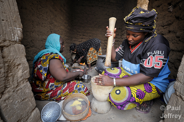 Ghaichatou Dicko (right), along with Aichatou Boiny (left) and Fadimoutou Dicko, prepare food for children at a school in Timbuktu, a city in northern Mali which was seized by Islamist fighters in 2012 and then liberated by French and Malian soldiers in early 2013. During the jihadi occupation, schools were first closed but then allowed to reopen only if boys and girls were strictly separated. The ACT Alliance has provided this group of women with cereal grains, oil and salt to help them provide nutritious food for the children.