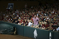 An Arkansas fan cheers, Saturday, June 5, 2021 during the seventh inning in the second game of the NCAA Fayetteville Regional at Baum-Walker Stadium in Fayetteville. Check out nwaonline.com/210606Daily/ for today's photo gallery. <br /> (NWA Democrat-Gazette/Charlie Kaijo)