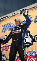 Sept. 18, 2011; Concord, NC, USA: NHRA funny car driver Matt Hagan celebrates after winning the O'Reilly Auto Parts Nationals at zMax Dragway. Mandatory Credit: Mark J. Rebilas-