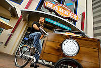 The Meat & Fish Company, based at Charlotte's 7th Street Public Market, delivers fresh meats and fish to Uptown Hotels on bicycle.  Building upon the success of Charlotte's Center City Green Market, the Seventh Street Public Market opened in 2012 to be a year-round market serving and celebrating local food artisans, entrepreneurs and local and regional farmers. Image is part of a series of photos taken of the Center City attraction.