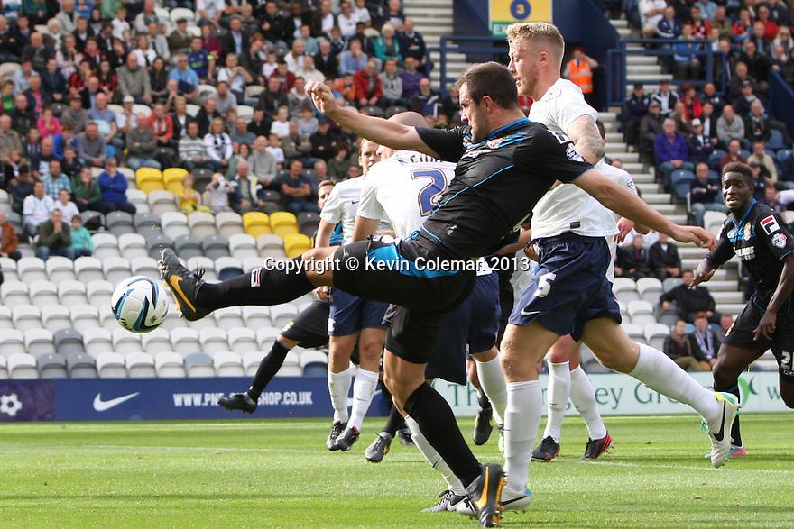 Peter Hartley of Stevenage crosses<br />  - Preston North End v Stevenage - Sky Bet League One - Deepdale, Preston - 14th September 2013. <br /> © Kevin Coleman 2013
