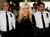 Queens New York_Victoria Gotti Agnello, 2000, daughter of jailed crime boss John Gotti, & wife of alledged Gambino capo Carmine Agnello, leaves Supreme Court in Kew Gardens  Photo by ©Neil Schneider/PHOTOlink