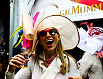 LOUISVILLE, KY - MAY 05: A woman smiles with her drink on Kentucky Oaks Day at Churchill Downs on May 5, 2017 in Louisville, Kentucky. (Photo by Jesse Caris/Eclipse Sportswire/Getty Images)
