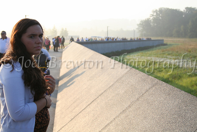 A young woman (who asked to remain nameless) pauses to reflect on the lives lost on Flight 93. Being of Muslim heritage, her family refused to attend the anniversary due to fear of alienation.