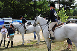 Young riders waiting for their horse show class to begin at Cheshire Fair in Swanzey, New Hampshire USA