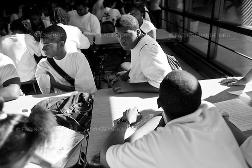 Chicago, Illinois<br /> USA <br /> September 2008<br /> <br /> Students at Robeson High live in one of Chicago's most  dangerous neighborhoods, Englewood is also one of the poorest neighborhoods in the city with a median income of $18,955 and a demographic of 97.8%  African Americans.  Roberson student face many challenges  as they enter school they have to walk through metal detectors witnesse fights and sometimes not have a clear idea of what they're doing on a day-to-day basis. In Chicago Public Schools, only around half the freshmen who enter high school will earn their diploma.  On August 18, 2010.  A 50-state report from the Schott Foundation for Public Education has come to a dispiriting conclusion: public education is failing black male students. Nationwide, the graduation rate for this demographic of students is a paltry 47 percent. And in some major cities, it's perilously low--in New York City and Philadelphia, for example, only 28 percent of black males complete high school on time.