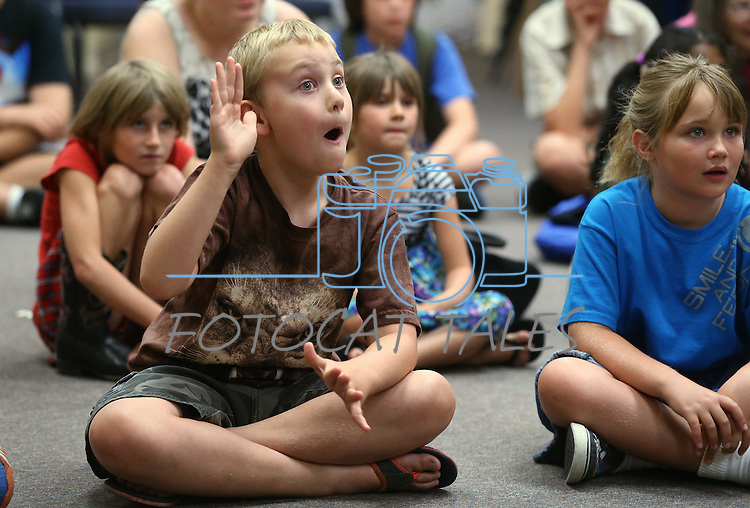 Aiden Jacklett, 6, watches the Mad Science program at the Carson City Library, in Carson City, Nev., on Tuesday, July 15, 2014.<br /> Photo by Cathleen Allison