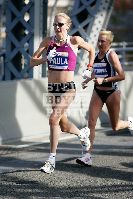 Paula Radcliffe (GBR) leads Ludmila Petrova (RUS) during the 2008 ING New York City Marathon on the Madison Avenue Bridge connecting the Bronx to Manhattan on November 2, 2008 in New York City, New York.  The racers enter Manhattan for the final time as they approach mile 21 on the course.  Radcliffe won the race with a time of 2:23.56.