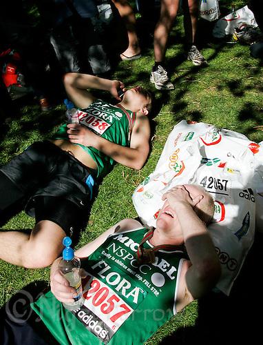 26 APR 2009 - LONDON,GBR - Adam Battye and Michael Battye recover after finishing - London Marathon. (PHOTO (C) NIGEL FARROW)