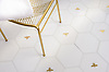 Napoleon and Bonaparte, a waterjet stone mosaic, shown in polished Calacatta Gold, Thassos, and Gold Glass, is part of the Aurora® collection by New Ravenna.