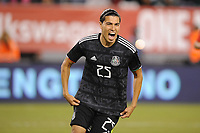 EAST RUTHERFORD, NJ - SEPTEMBER 7: Erick Gutierrez #25 of Mexico celebrates his score during a game between Mexico and USMNT at MetLife Stadium on September 6, 2019 in East Rutherford, New Jersey.