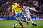 Victor Machin Perez of UD Las Palmas (L) fights for the ball with Daniel Ceballos Fernandez, D Ceballos, of Real Madrid (R) during the La Liga 2017-18 match between Real Madrid and UD Las Palmas at Estadio Santiago Bernabeu on November 05 2017 in Madrid, Spain. Photo by Diego Gonzalez / Power Sport Images