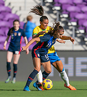 ORLANDO, FL - FEBRUARY 21: Alex Morgan #13 of the USWNT fights for the ball with Rafaelle #4 of Brazil during a game between Brazil and USWNT at Exploria Stadium on February 21, 2021 in Orlando, Florida.