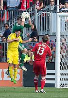 18 May 2013: Toronto FC goalkeeper Joe Bendik #12 and Columbus Crew midfielder Matias Sanchez #8 in action during an MLS game between the Columbus Crew and Toronto FC at BMO Field in Toronto, Ontario Canada..The Columbus Crew won 1-0...