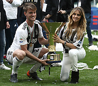 Calcio, Serie A: Juventus - Hellas Verona, Torino, Allianz Stadium, 19 maggio, 2018.<br /> Juventus' Daniele Rugani celebrates with the trophy and his girlfriend Michela Persico during the victory league ceremony at Torino's Allianz stadium, 19 May, 2018.<br /> Juventus won their 34th Serie A title (scudetto) and seventh in succession.<br /> UPDATE IMAGES PRESS/Isabella Bonotto