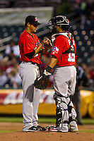 Martin Perez (45) of the Frisco RoughRiders talks with Catcher Jose Felix (18) during a game against the Springfield Cardinals on April 14, 2011 at Hammons Field in Springfield, Missouri.  Photo By David Welker/Four Seam Images.